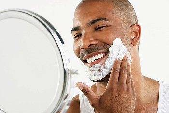 Man with sensitive skin applying shave cream