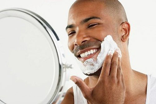 Man applying shaving cream for sensitive skin